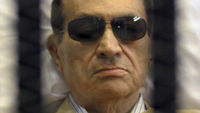 Egypt's former leader Hosni Mubarak behind bars in a courtroom (Reuters)