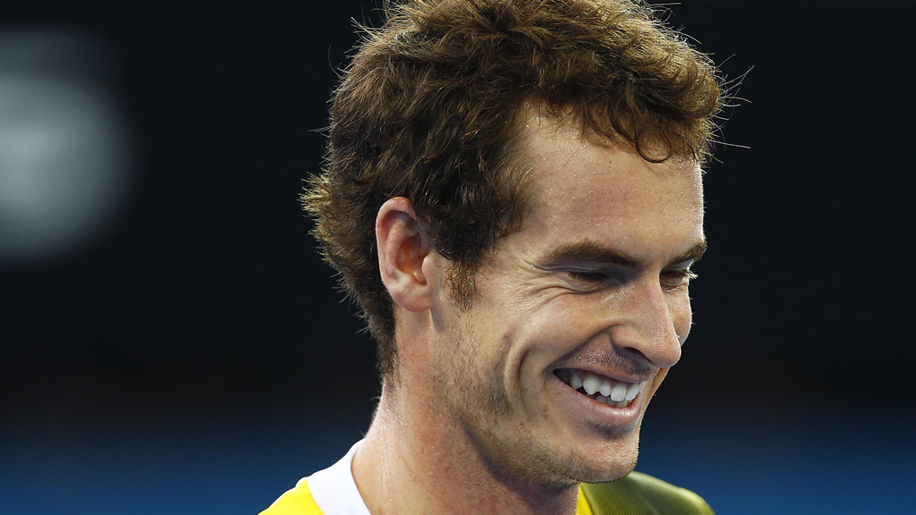 Andy Murray smiles on court. (Reuters)