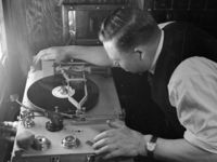 May 1946: Mr J Lovelock checking a new disc at the HMV recording studios during the recording of music for the film Spring Song. (Photo by George Konig/Keystone Features/Getty Images)