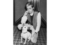 July 1982: Singer and guitarist Nick Heyward, of Haircut 100, with Nipper, the HMV dog at the Silver Clef pop awards in July 1982. (Photo by Dave Hogan/Hulton Archive/Getty Images)
