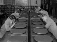 May 1930: A row of record turntables on a production line at the HMV factory in Hayes. (Photo by Fox Photos/Getty Images)