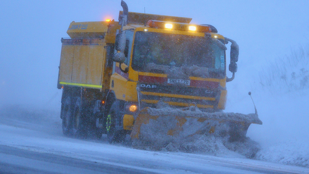 A snow plough makes way down the A68 on January 21, 2012 in Lauder, Scotland (Getty)