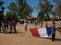 The French flag flies alongside the Malian in Diabaly. Before the French arrived, residents had endured 10 days of occupation by jihadis and then French airstrikes.