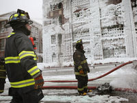 More than 200 fire-fighters worked to extinguish a blaze at a vacant warehouse on Chicago's south side.