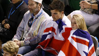 Tennis fans draped in union flags watch Andy Murray beat Roger Federer. (Reuters)