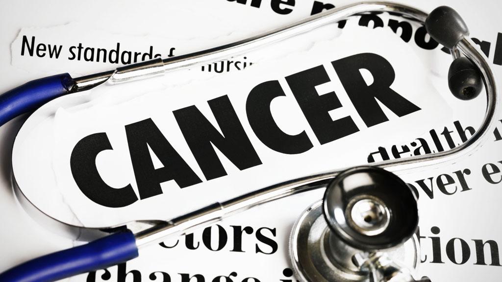 'Cancer' headline on newspaper (getty)