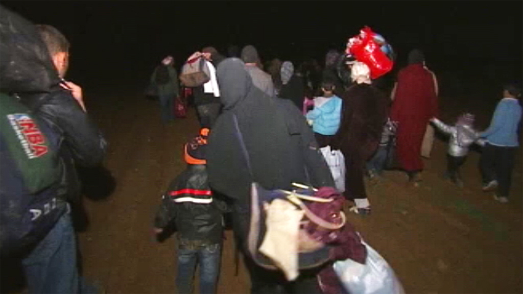 Channel 4 News Foreign Correspondent Jonathan Miller witnesses the dramatic late-night escape and rescue of a group of Syrian refugees, fleeing their homeland under fire and crossing into Jordan.