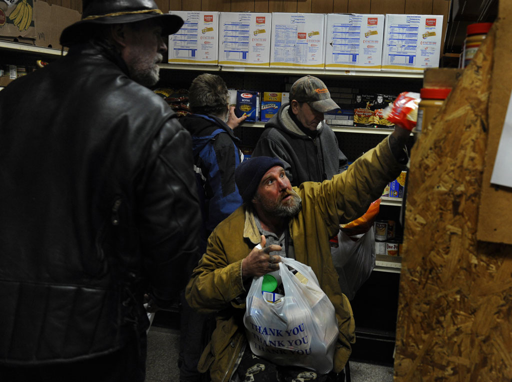 Residents at a food bank in Rhode Island, US (Getty)