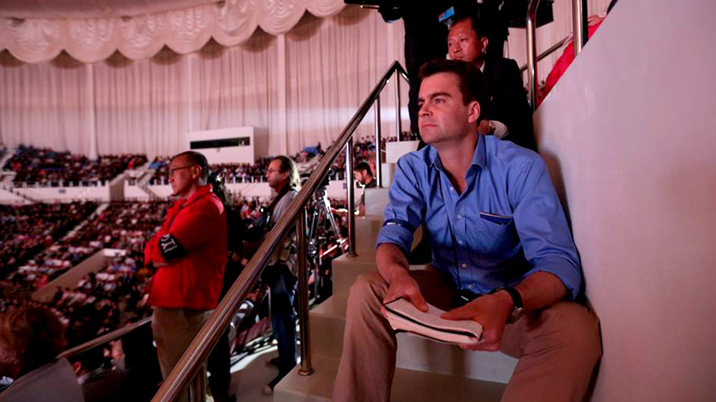 John Sparks at a political rally in North Korea.