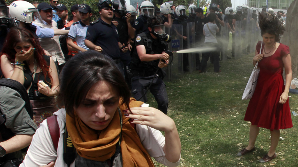 Police fire teargas at a woman in Taksim Square, Turkey, as protestors gather to protect a park from redevelopment (picture: Reuters)