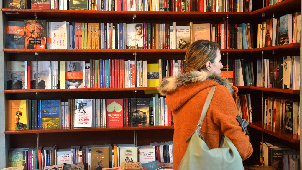 Woman browses in a bookshop (G)