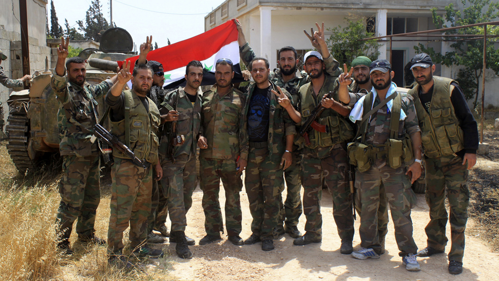 Syrian government soldiers in the town of Debaa, near Qusayr, which they captured with help from Hezbollah (pictures: Reuters)