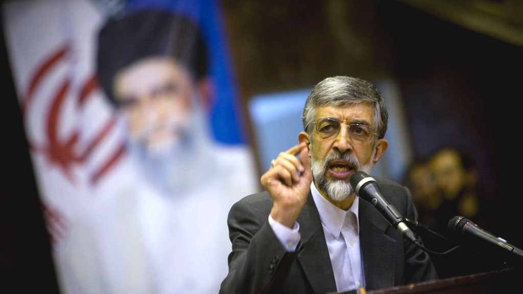 Gholam-Ali HaddadAdel, a relative of Iran's Supreme Leader Ayatollah Khamenei, drops out of the presidential race and asks his followers to vote for his hardline conservative colleagues.
