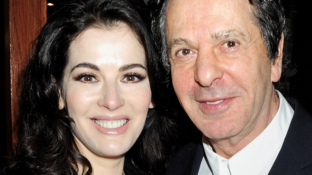 Charles Saatchi says pictures in which he appears to hold his wife Nigella Lawson by the neck were just a 'playful tiff' (picture: Getty)