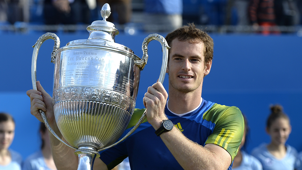 Andy Murray lifts the trophy at Queen's Club, London, after his 2013 win.