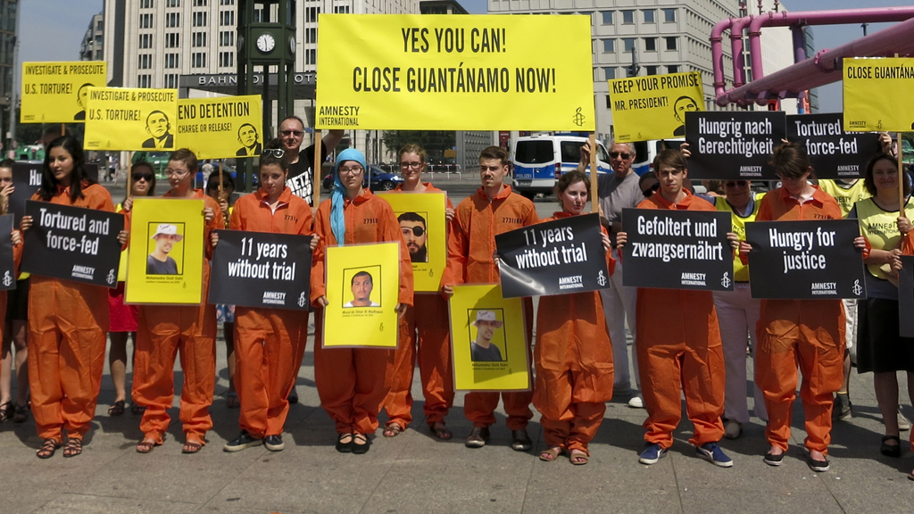 Protests aimed at Barack Obama's Berlin visit included one by Amnesty International activists over the continued detention of suspects at Guantanamo Bay (picture: Reuters)