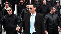 Golden Dawn spokesman Ilias Kasidiaris outside court (Getty)