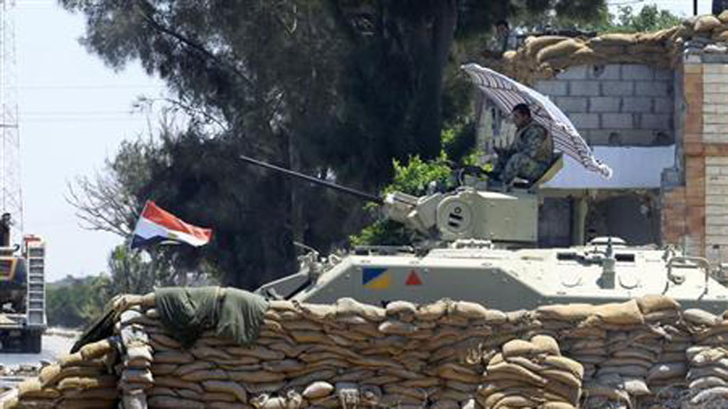 An Egyptian soldier guards a checkpoint at Rafah city (pic: Reuters)