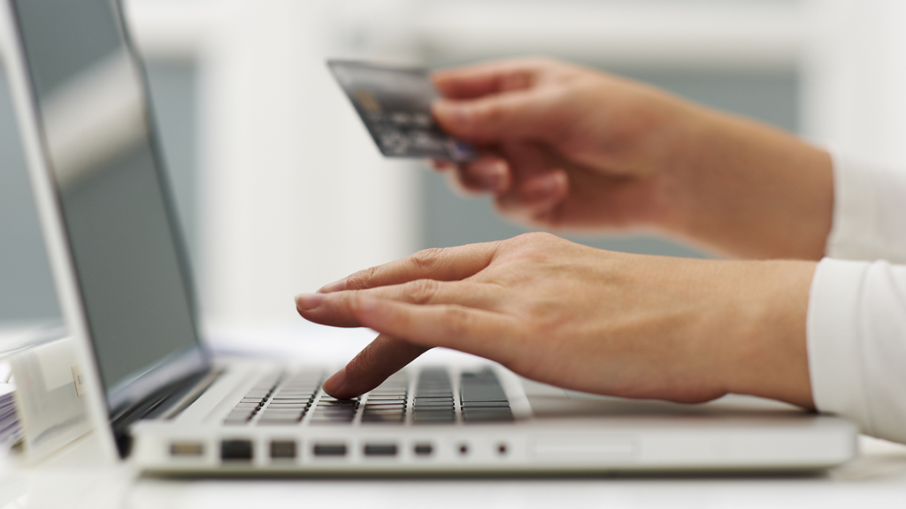 A credit card being used to buy something online (G)