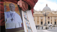 Newspaper showing Pope Francis, held in St Peter's Square, Rome (G)