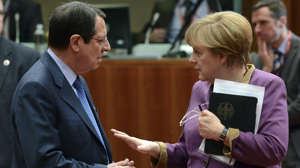 Cyprus' President Nicos Anastasiades with German Chancellor Angela Merkel at bailout talks on Friday (picture: Reuters)