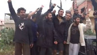 Released rebel prisoners celebrate after base's capture
