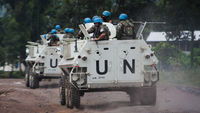United Nations armoured personnel carriers drive towards a UN base in Monigi, 5kms from Goma, in eastern Democratic Republic of the Congo (Getty)