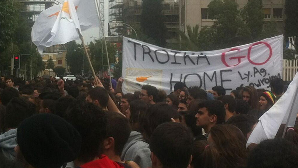 Thousands of schoolchildren take to the streets of Nicosia to demonstrate against the terms of an international bailout for Cyprus.