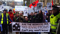 Anti bedroom tax protesters carrying banner on the march to George Square, Glasgow (G)