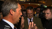 Ukip leader Nigel Farage compares parts of the Scottish nationalism campaign to fascism after police rescued him from a pub surrounded by angry protesters calling him