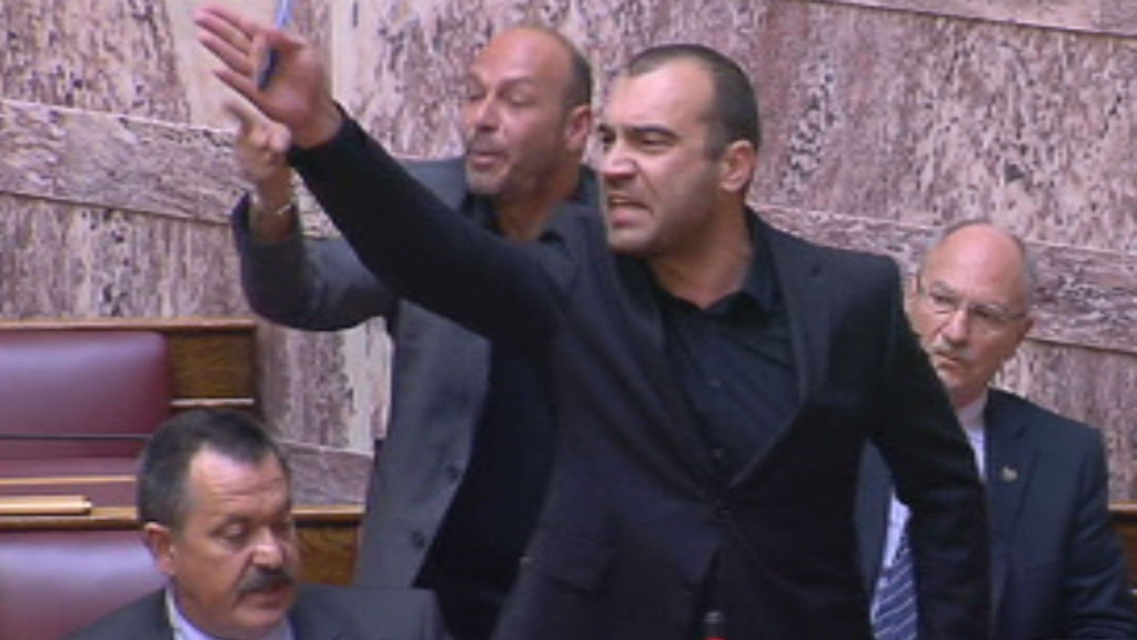 Uproar erupts in the Greek parliament as an MP from the far-right Golden Dawn party is expelled amid shouts of