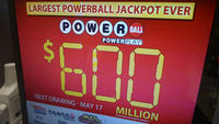 A monitor at a gas station shows the jackpot for the next Powerball lottery on May 18, 2013 in Bethesda, Maryland (Getty)