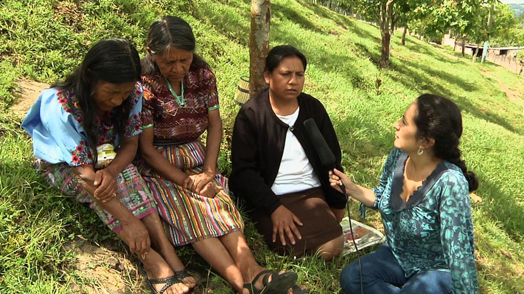Ana Lucia Cuevas interviews survivors.