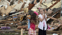 The search for survivors is underway after a two mile-wide tornado tore through Oklahoma City, trapping victims beneath rubble and flattening a school.