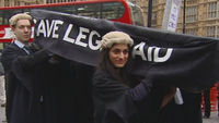 Lawyers protest against planned changes to legal aid (ITN)