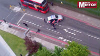 Woolwich attack: video footage shows moment police shoot on suspects