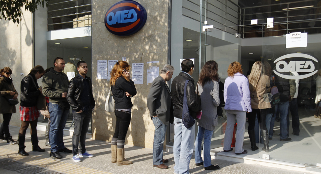 Unemployed Greeks queue at a job centre in Athens