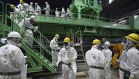 Inside Fukushima Dai-ichi, workers and journalists observe the clean-up (Reuters)