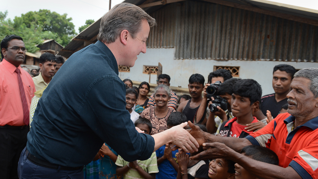 David Cameron meets with Sri Lankan Tamils at a refugee village in Jaffna (picture: Getty)