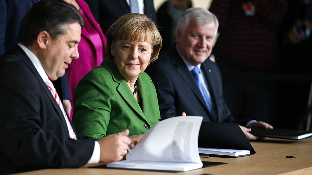 Germany's 'grand coalition' document is signed by Angela Merkel (Image: Reuters)