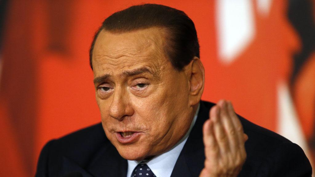 Silvio Berluscon (R)