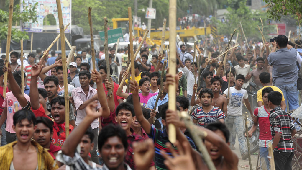 Workers during a protest to demand capital punishment for those responsible for the collapse of the Rana Plaza building in Savar, outside Dhaka, Bangladesh in April (G/R)