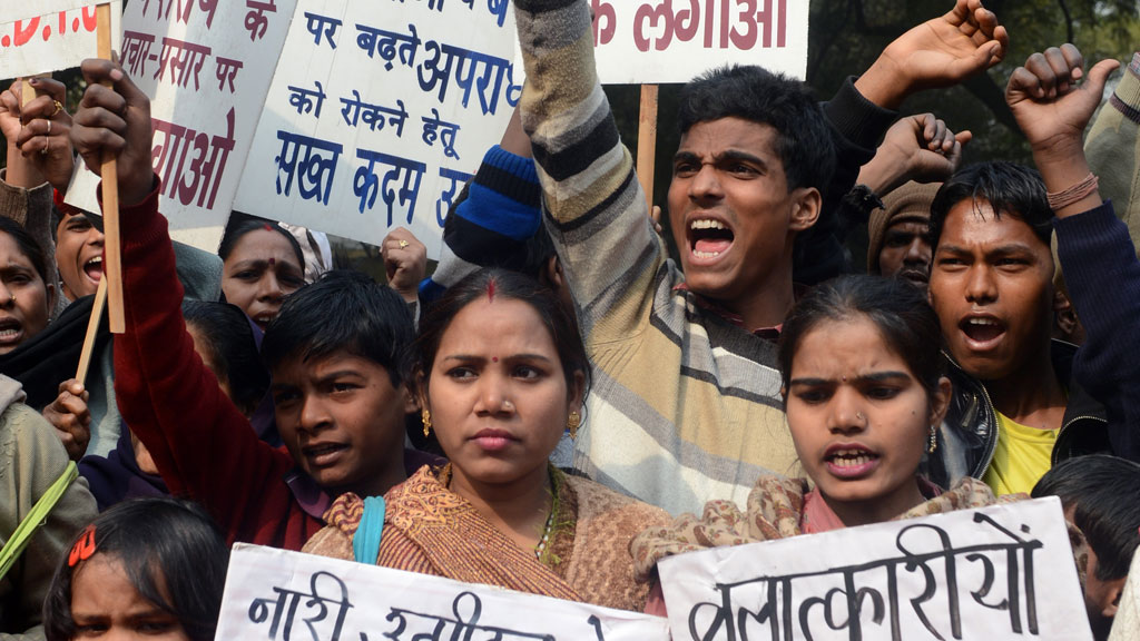 Indian demonstrators shout slogans during the one-month anniversary of the gang rape and murder of a student in New Delhi in January (G/R)