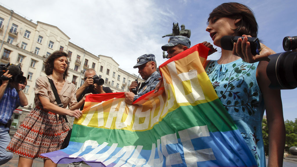 Gay rights activists take part in an opposition protest march in Moscow in June calling for Russian President Vladimir Putin's resignation and the release of activists facing long jail terms (G/R)