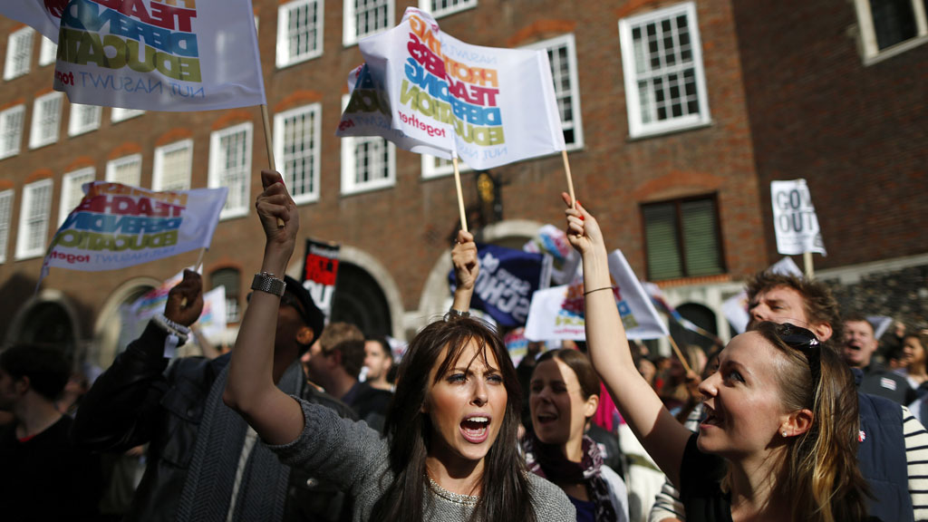 A teacher shouts slogans outside the Department of Education during a protest by striking education workers in central London in October (G/R)