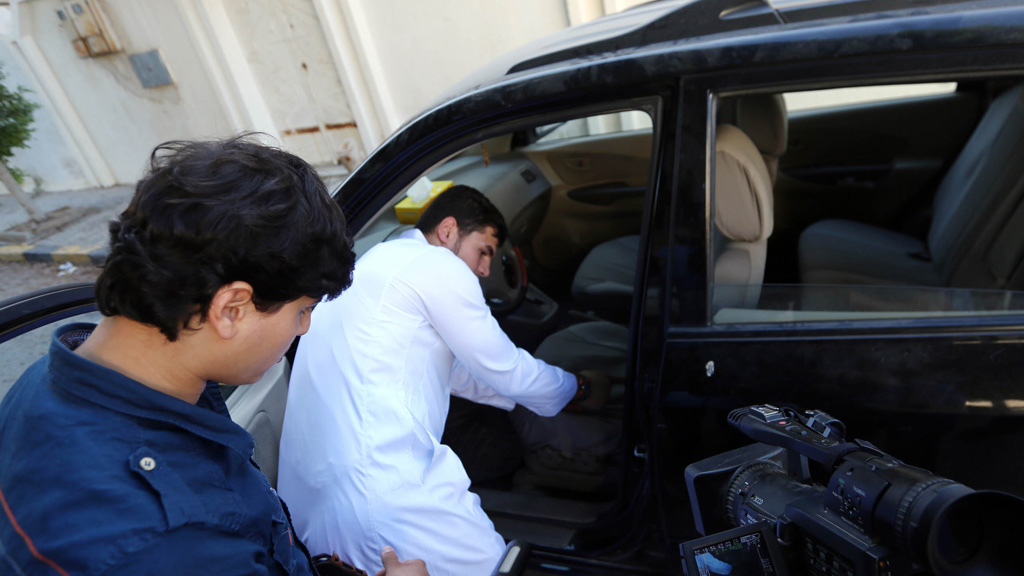 Al-Libi's son shows reporters the car that the suspected al-Qaeda operative was taken from (picture: Getty)