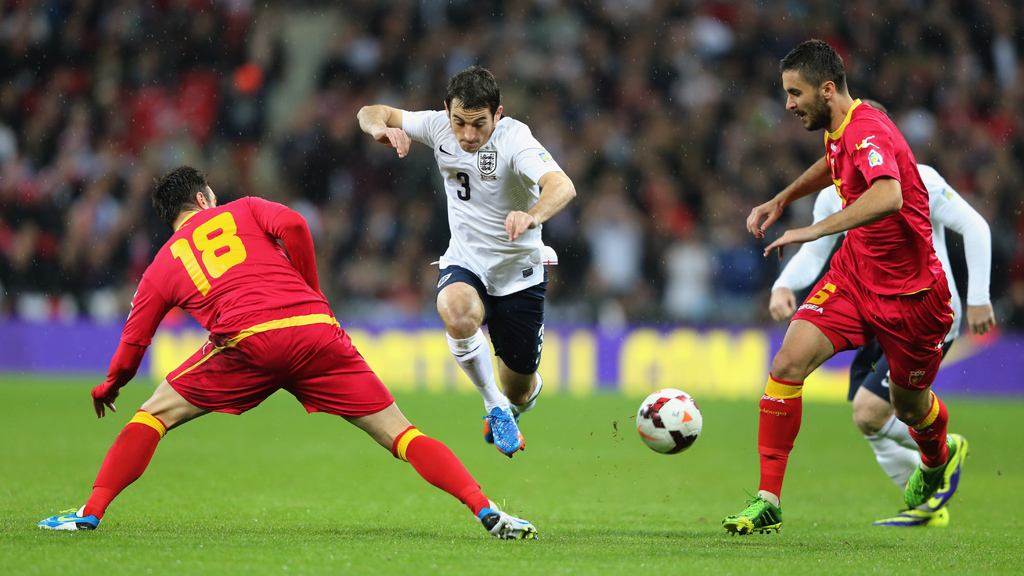 Leighton Baines of England takes on Nikola Drincic and Ivan Kecojevic of Montenegro (Getty)