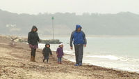 Karen and Gary Marquick, with their two children, on a Dorset beach
