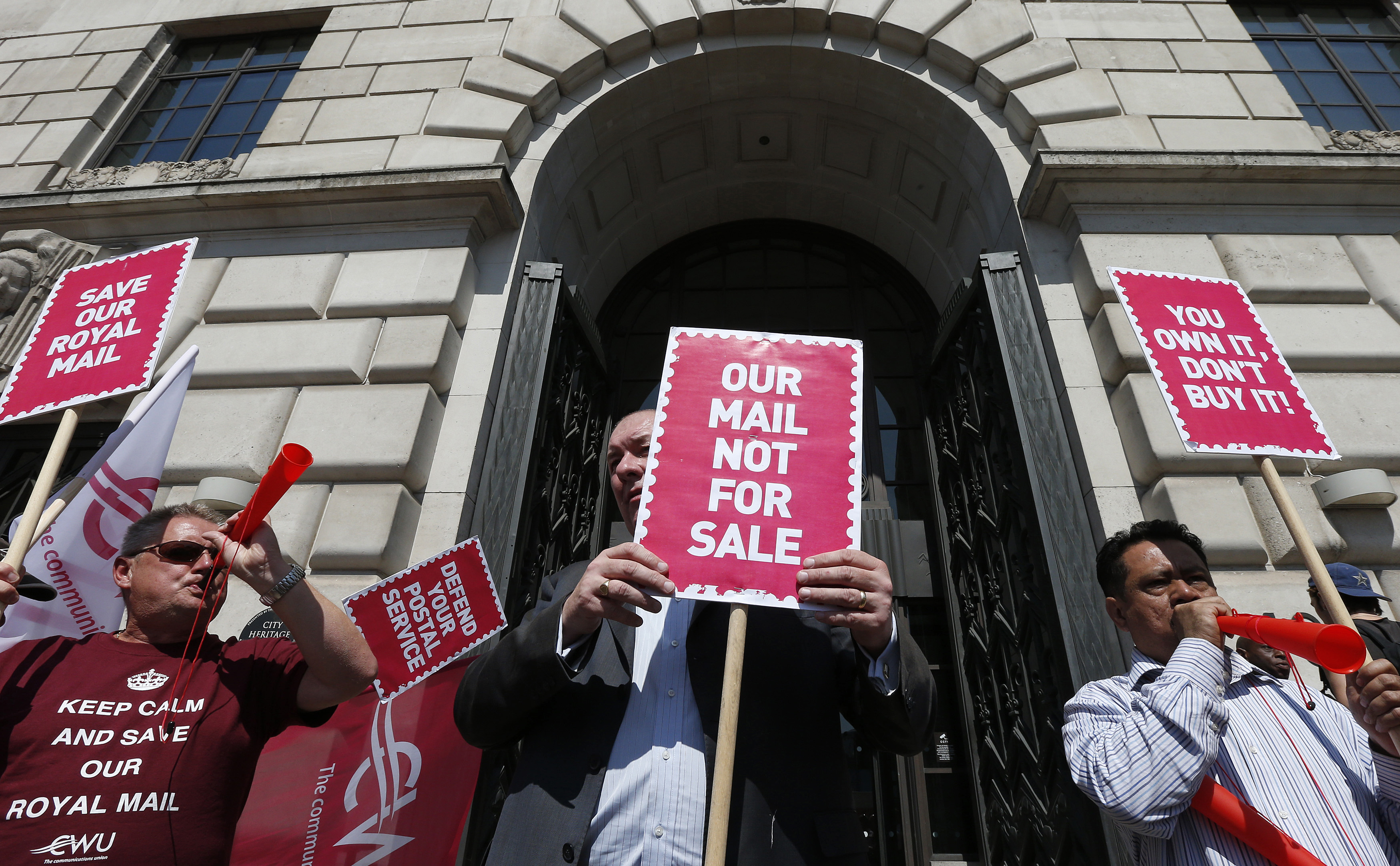 Trade unionists protest at the privatisation of Royal Mail (Reuters)