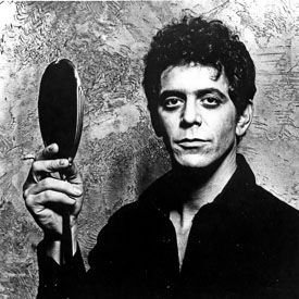 Lou Reed posing for a portrait in the 1970s, with a mirror (getty)